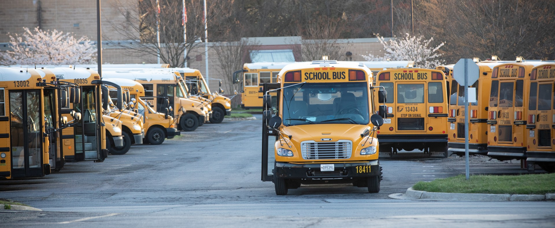 School buses line the parking lot outside Manna Food Center.