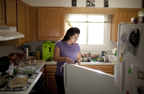 Woman looking into refrigerator