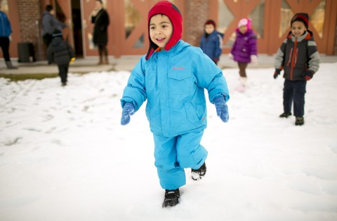 boy running in the snow